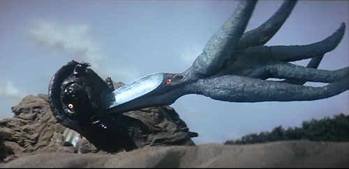WHY GAMERA, I DIDN'T KNOW YOU WERE INTO SCISSORING, YOU OLD LESBIAN!